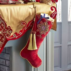 This red velvet stocking brings an elegant touch to a holiday vignette, embroidered with beads and trimmed with tassels. Unique Christmas Stockings, Green Stockings, Christmas Tree Napkins, Diy Stockings, Indoor Christmas Decorations, Christmas Tree Themes, Christmas Candles, Nordic Christmas, Christmas Sewing