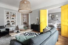 Living room with yellow double doors to the bedroom