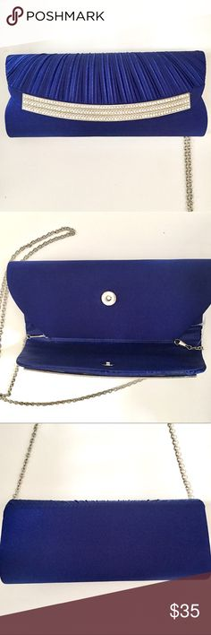 "New Satin Navy Blue Clutch / Shoulder Bag Beautiful elegant Silky Blue Clutch with optional Shoulder strap. Cellphone pocket inside! This little bag is from a Store called Attitude in South Africa. 10"" wide. Well made. Brand New, never been used. Make an offer or Bundle for 10% off. Attitude Bags Clutches & Wristlets"