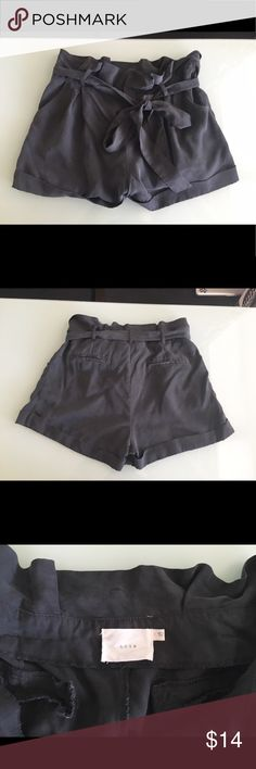 Lush High Waisted Belted Shorts in Deep Grey Lush High Waisted Belted Shorts in Deep Grey. Size small that measures 15 inches across waist, 3 inch inseam and 12 inches long. Fits a size 0 or 2. Deep grey tencel material that feels like a thicker silk. Perfect new condition. No flaws. Lush Shorts