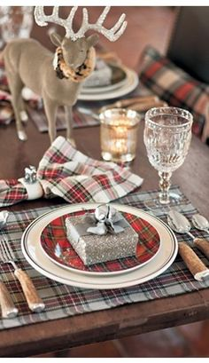 A rustic holiday tablescape. This mix of old & new includes tartan plaids, cut crystal, and wooden flatware.