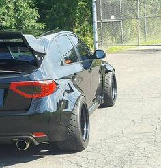 ..at first glance I thought it was a kitted out BMW X5.. haha ...but actually a Subaru Impreza WRX STi