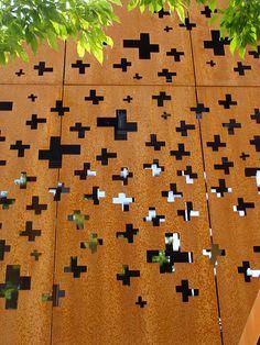 Randomly placed asymmetric crosses. Center Rheinfall Schloss Laufen in Rheinfall, Switzerland by Leuppi & Schafroth Architekten