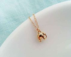 This adorable gold elephant necklace.