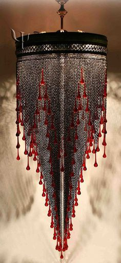 Sooo Art Deco and GOTHIC. Another pinner's suggested useing similar glass from bead store to dress up an existing chandelier Regal, Gothic and looks like dripping blood. Chandeliers, Chandelier Lighting, Gothic Chandelier, Moroccan Chandelier, Floral Chandelier, Lamp Light, Light Up, Light Fixture, Art Nouveau