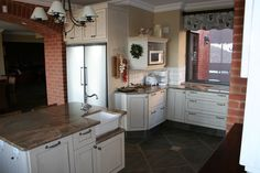 $739000. Property 16. Kitchen. Open plan with separate scullery and pantry. Granite tops.