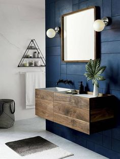 We love the geometric print in the wall that perfectly complements the sharp lines of the sink and sleek square shape of the mirror.