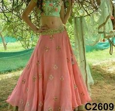 Peach lehenga and green crop top To purchase this product mail us at houseof2@live.com  or whatsapp us on +919833411702 for further detail #sari #saree #sarees #sareeday #sareelove #sequin #silver #traditional #ThePhotoDiary #traditionalwear #india #indian #instagood #indianwear #indooutfits #lacenet #fashion #fashion #fashionblogger #print #houseof2 #indianbride #indianwedding #indianfashion #bride #indianfashionblogger #indianstyle #indianfashion #banarasi #banarasisaree