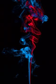 Smoke On Blue And Red Neon Color In Black Background