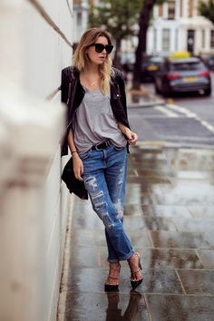 Ripped jeans, slouchy gray top, casual chic! Women's street style fashion outfit