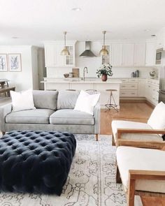 modern farmhouse living room design, modern farmhouse family room decor with white walls, modern sofa and neutral throw pillows and neutral area rug, neutral living room design My Living Room, Home And Living, Living Room And Kitchen Together, Living Room Neutral, Living Room Decor Blue, Living Room White Walls, Modern White Living Room, Living Room Trends, Urban Living Rooms