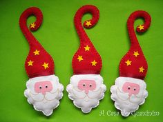 "Adorable Santa door hangers from Rita Maia at ""A Casa do Guaxinim"" See her Etsy shop here: http://www.etsy.com/shop/acasadoguaxinim"