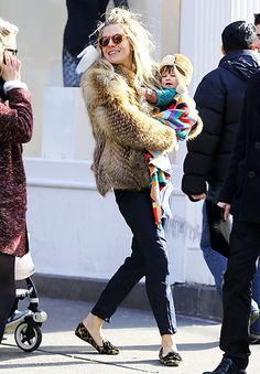 Sienna Miller beamed holding baby daughter Marlowe during a stroll in NYC Feb. 12.