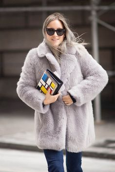 Charlotte Groeneveld is wearing a grey Whistles fluffy coat for winter.