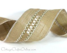 """Embellished, 4"""" wide natural jute burlap ribbon, has an open center with a decorative weave highlighted with white cord. White thread covering the wired edge emphasizes the center embellishment."""