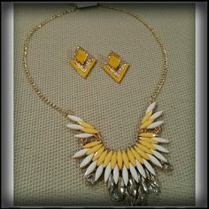 YELLOW RESIN & ENAMEL STATEMENT SET A beautiful yellow set.  The necklace is resin and crystals with goldtone mrtal backing.  The earrings are yellow enamel. Jewelry Necklaces