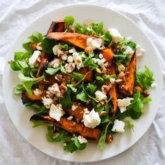 Delicious autumn salad with oven roasted pumpkin, goats feta and roasted hazelnuts