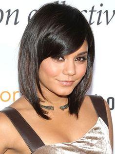 shoulder-length hair.