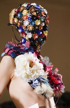 A model dons a floral headdress for Maison Martin Margiela's Haute Couture Fall/Winter 2013 collection for Paris Fashion Week.