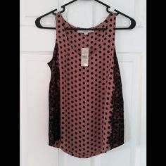 "Ann Taylor LOFT Polka Dot Tank This top is NWT! It is a size xs petite. It is a muted pink/mauve color with black polka dots and black lace on each side. It is approximately 17"" across the bust when laid flat. It is approximately 21 1/2"" from shoulder to hem on the sides and 24"" in the center. Body:  100% polyester, Lace:  100% nylon LOFT Tops Tank Tops"