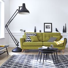 The Ercol Cosenza collection features retro designs with a mid century modern appeal. We love the pop of colour that this lime green sofa brings to a monochrome interior.