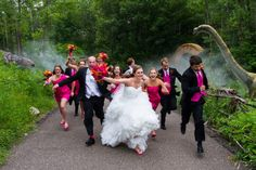 Fun wedding party photo idea! Run from those dinosaurs. Photo by Christopher J Photography