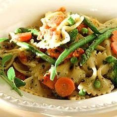 Bow Ties with Spring Vegetables, Roasted Garlic Recipe - Vegan version:  Use Vegan Butter or Margerine by Earth Balance/Vegetable Stock/Parmesan cheese by Galaxy Nutritional Foods  http://www.wolfgangpuck.com/recipes/view/3288/Bow-Ties-with-Spring-Vegetables--Roasted-Garlic