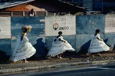 BRAZIL. Rio de Janeiro. 1980. Samba celebrants returning home after the Carnival.