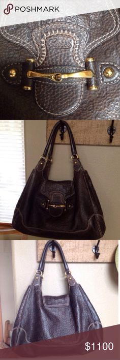 "🍃💕Gucci Pelham Horse Bit Handbag Gorgeous beyond words💕Authentic Gucci Pelham Bag. Rich brown signature embossed pebbled leather, rich gold tone horse bit hardware/footed bottom, blanket stitch details. In EUC, pristine both in and out with slight wear at bottom corner seaming! Handles have acquired a rich patina from handling. Just beautiful and sized to hold everything. Measures 12"" high x 15.5"" long x 7"" deep, this indeed is a large sized handbag. Made in Italy. Dust bag is included…"