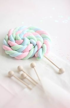 This recipe for Homemade Marshmallow Rope is pretty fantastic! You can do so much with it including these awesome lollipops!!