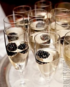 Ideas for your wedding drink - just pop some blackberries into your champagne.