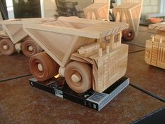 This wooden toy mine haul truck has rolling wheels, a tipping tray and lots of detail. It is made with natural pine body and maple wheels, finish is beeswax which is locally sourced and gives a safe, smooth and warm finish. Strong and sturdy for hours of play time. Also good for mementos