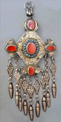 Shartuyme ornament from Karakalpakstan, Uzbekistan, having carnelian surrounded by small turquoise, gilt silver, mid 19th c (info@singkiang.com)