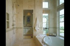 Hickman Design Associates, Master Shower and tub room with view into walled garden flanked by his/her vanity rooms