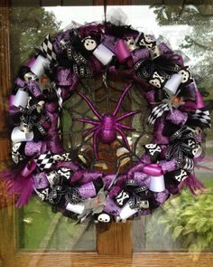 This Goth Wreath in purple and black was created by one of our designers! Very spooky!