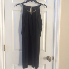 White House Black Market black dress NWOT WHBM black sleeveless dress, keyhole and silver hardware. Super cute! White House Black Market Dresses