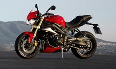 The 675cc Street Triple in Diablo Red for 2015.