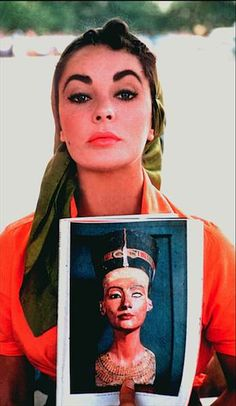 Elizabeth Taylor with the Bust of Nefertiti (c. 1345)..the similarity is scary!