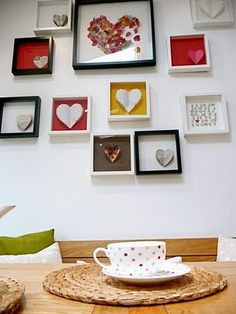 I love collage picture frame walls. If you look at the coloured backgrounds behind the hearts, they really give the wall a 'pop' of colour without being too obnoxious. A clever way of adding colour to a room - we can all take a page out of interior design when designing your jewelry...it's the same principles!!
