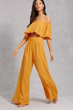 A chiffon crop top featuring an open-shoulder design, short sleeves, adjustable cami straps, a flounce ruffle layer as well as a pair of woven pants featuring a zip-fly with a hook-eye closure at the back and a wide-leg.<p>- This is an independent brand and not a Forever 21 branded item.</p>