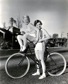 Muriel Evans gives Mary Carlisle a ride. 1933