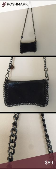 """Cross body Stella McCarthy """"like"""" black bag Super adorable genuine leather, black metallic and shiny. Silver strap and silver detail lining the outside of the bag which has a flap that flips over and clasps with the Magnetic button inside of the bag there is a zipper to close the bag from the inside. Looks very similar to a Stella McCarthy so super cute BORSE IN PELLE Bags Crossbody Bags"""