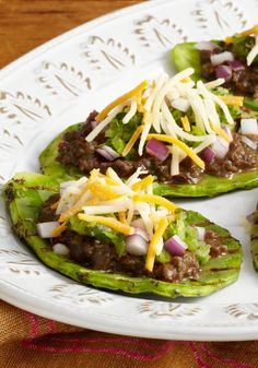 Try something new with our Grilled Nopales Huaraches. These delicious Grilled Nopales Huaraches are topped with beans, cheese and spicy tomatillo salsa. Kraft Foods, Kraft Recipes, Cactus Food, Cactus Salad, Mexican Dishes, Mexican Food Recipes, Vegan Recipes, Cooking Recipes, Paleo Vegan