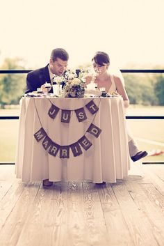 sweetheart table instead of a head table.. great idea!! allows your wedding party to sit with their spouses/loved ones. :) then we don't have to talk to people while we are trying to eat. Hmmm. Interesting idea I must say!