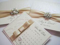 Luxury lace, satin and pearl wedding stationery