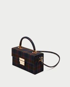 ZARA | £29.99 | Rigied printed minaudière bag in navy, red and green check