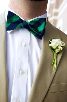 The boutonnieres and corsages will be ivory spray roses wrapped in thin green linen with the stems showing.  The groom's boutonniere will have ivory linen to stand out.