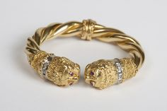 Jewelry, armrings and bracelets. Bangle Gold 750, with brilliant-cut diamonds together approximate 0, 20 ct and rubies, 80, 2 g;