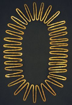 Necklace | Alexander Calder. c. 1940.  Hammered brass.