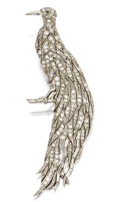 A platinum, diamond and onyx bird brooch, Lacloche Frères, Paris, Circa 1915.